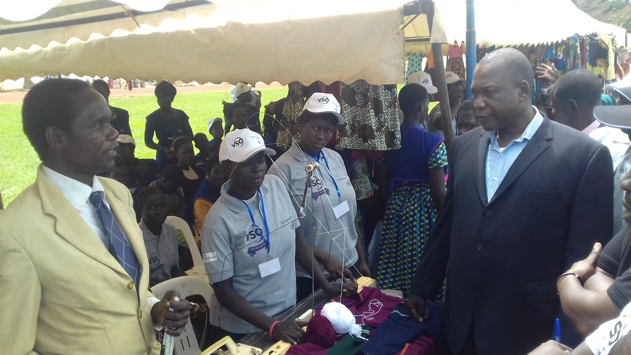 Rwot David Onen Acana II inspect stalls of youth exhibition of project outputs at Pece war memorial stadium in Gulu town (PHOTO BY DavidOkema)