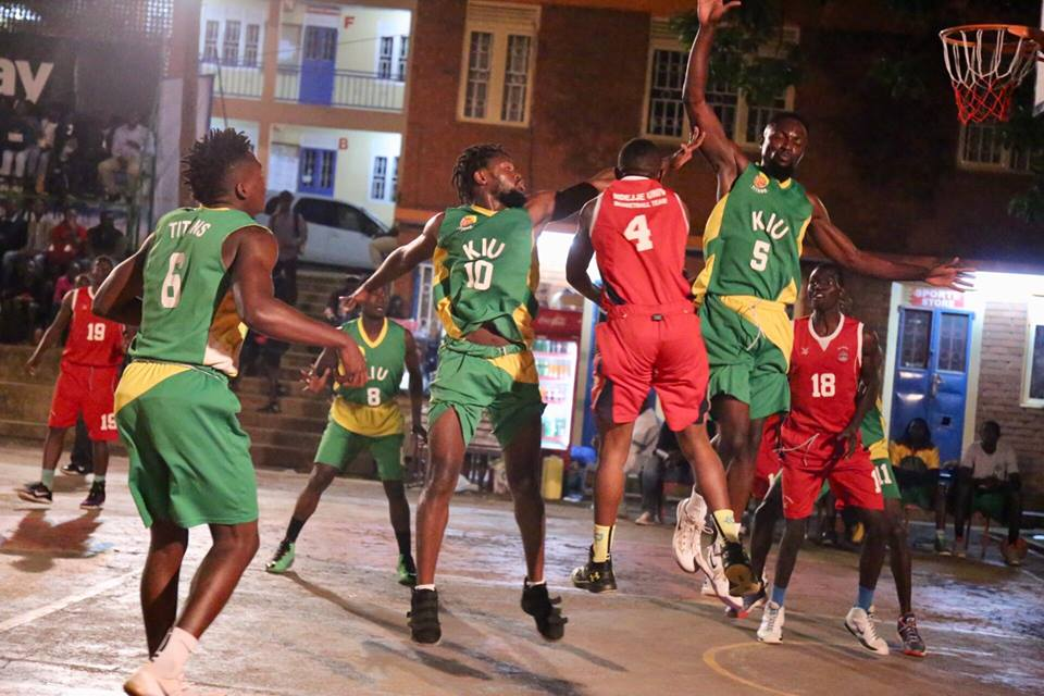 Ndejje's Nunda Kiryowe tries to execute a lay up as KIU's Micheal Bwanga (10) and Collin Kasujja try to stop him yesterday (Photo by FUBA Media)