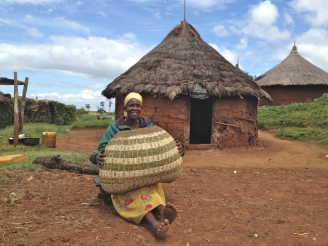 A-Benet-woman-sits-outside-her-hurt-after-weaving-a-basket. (PHOTO: MAFABI)