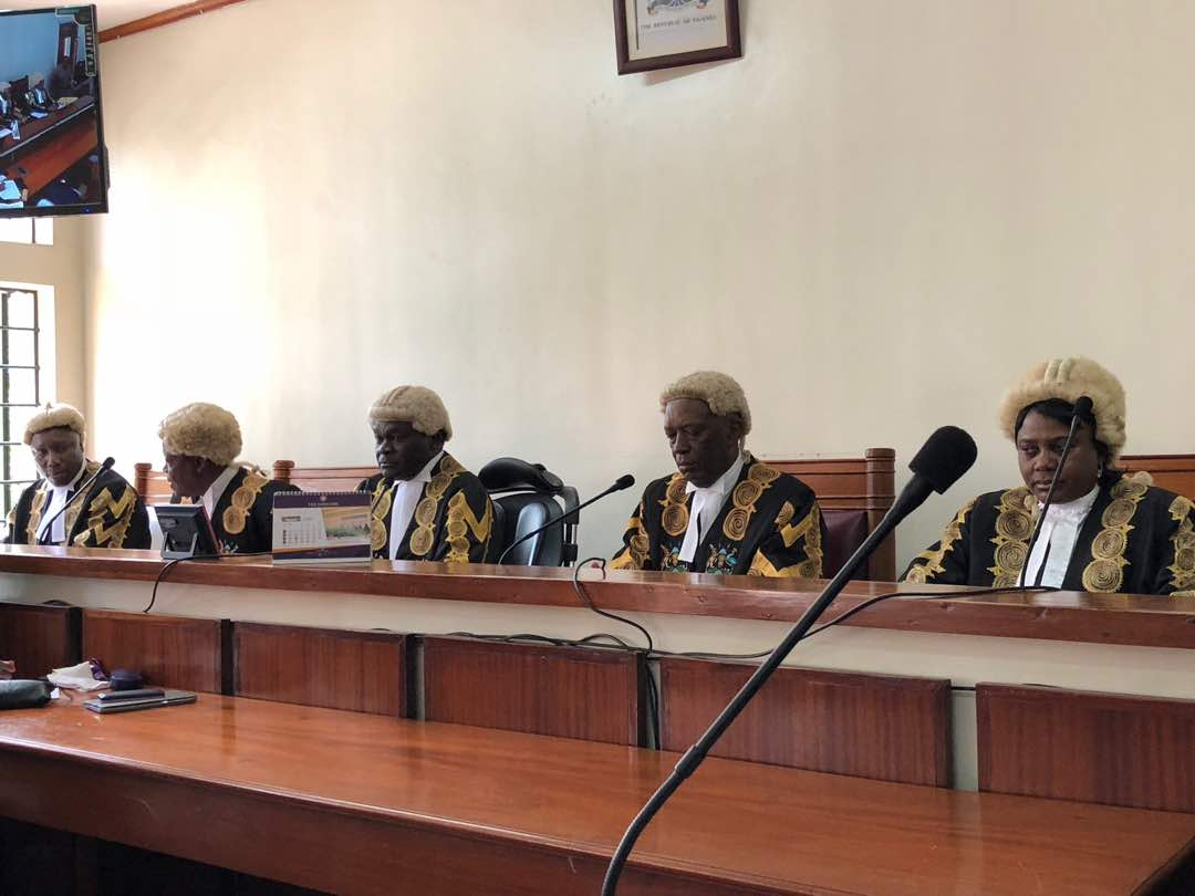 Constitutional Court judges headed by Deputy Chief Justice Alfonse Owiny-Dollo (middle) set to deliver its judgement onpresidential age limit petitions today July 26. (FILE PHOTO)