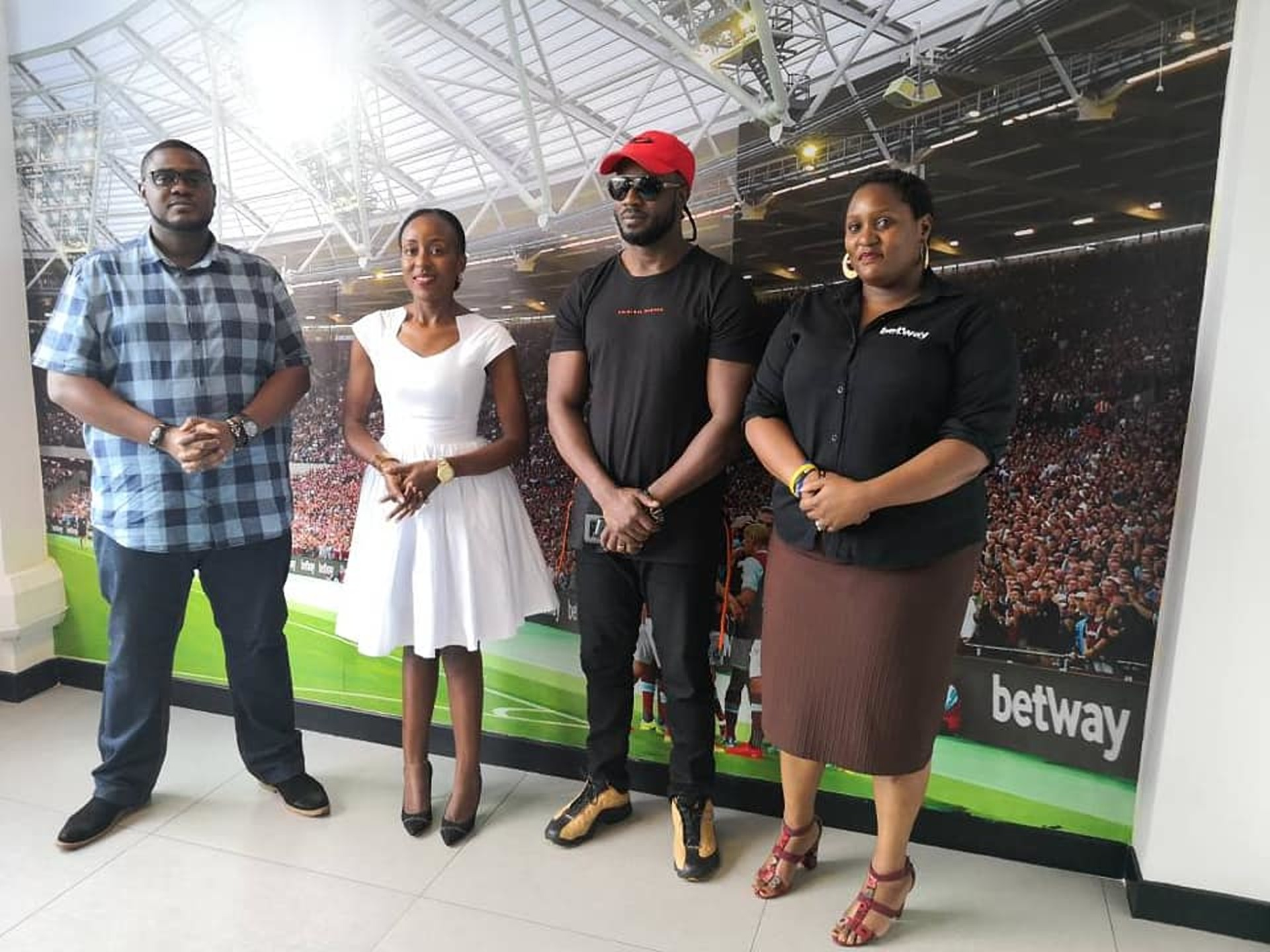Artiste Moses Ssali alias BebeCool unveils the partnership with BetWay for the upcoming concert as officials look on