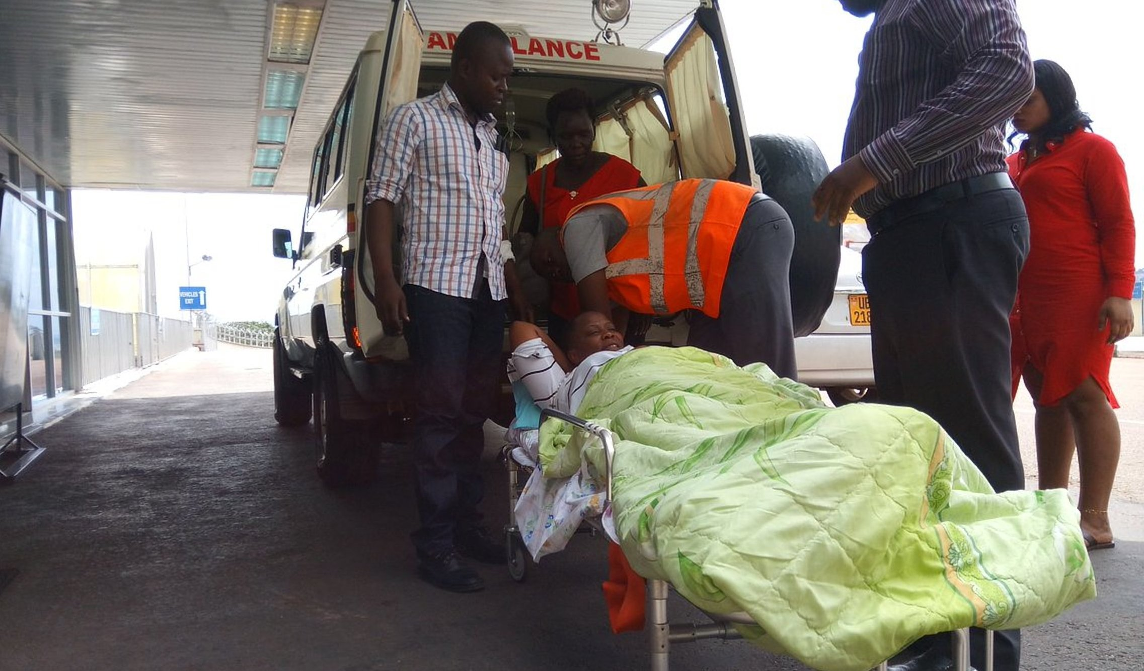Hon. Betty Nambooze arrives at Entebbe international Airport to be airlifted for further treatment Tuesday afternoon