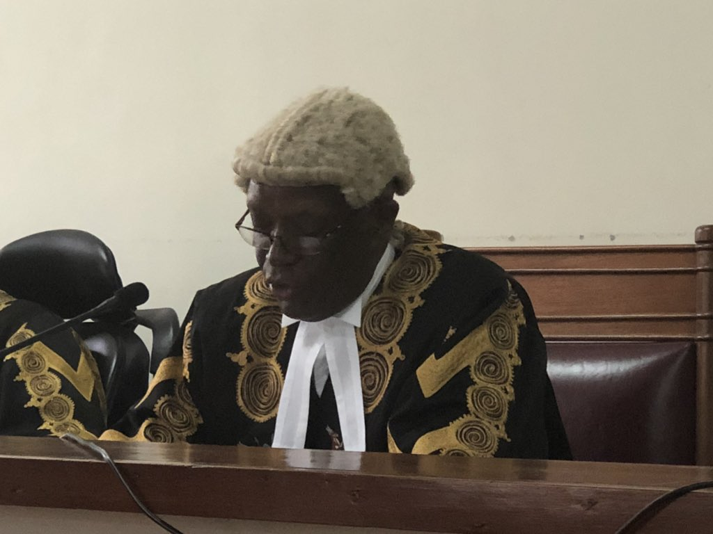 he justices led by Justice Kenneth Kakuru dismissed with costs, an  application by the Attorney General that had sought to stay execution of orders that were made by the High Court judge Andrew Bashija saying that the government will suffer loss of over UGX. 9 billion in questionable claims of payments to the respondent -- Mr. Daniel Walugembe, a land dealer.
