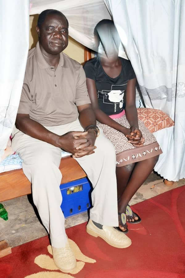 Charles Onekgiu is pictured with the young girl in photos that caused outrage leading to his arrest (Photo: Police)