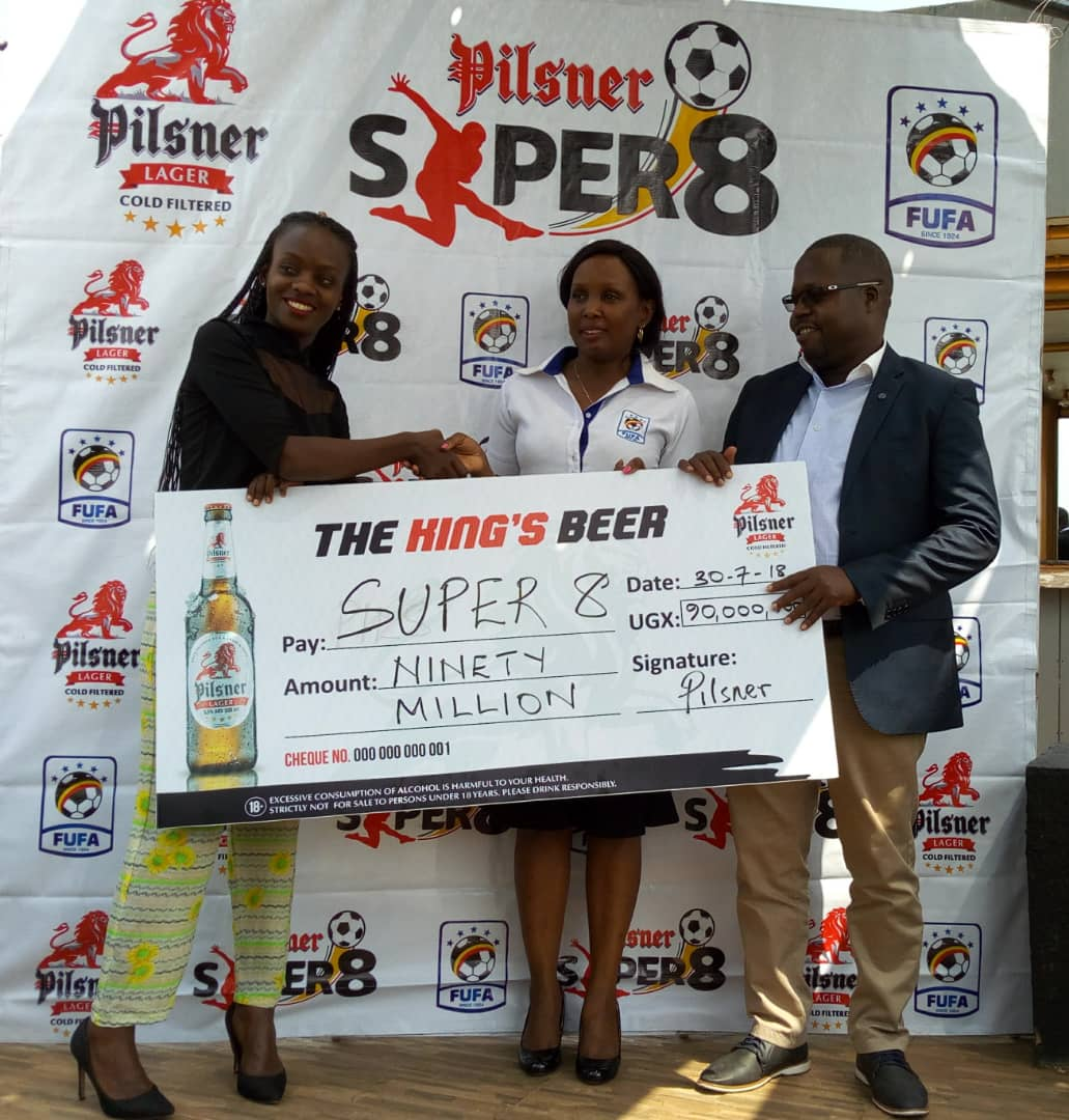 Catherine Twesigye- Pilsner Brand Manager (Left), Esther Musoke - FUFA Marketing Manager (center) and Rogers Byamukama FUFA Excom Member & Chairman Marketing Committee (right) at the launch of the Super 8 on Monday (Photo by FUFA Media)
