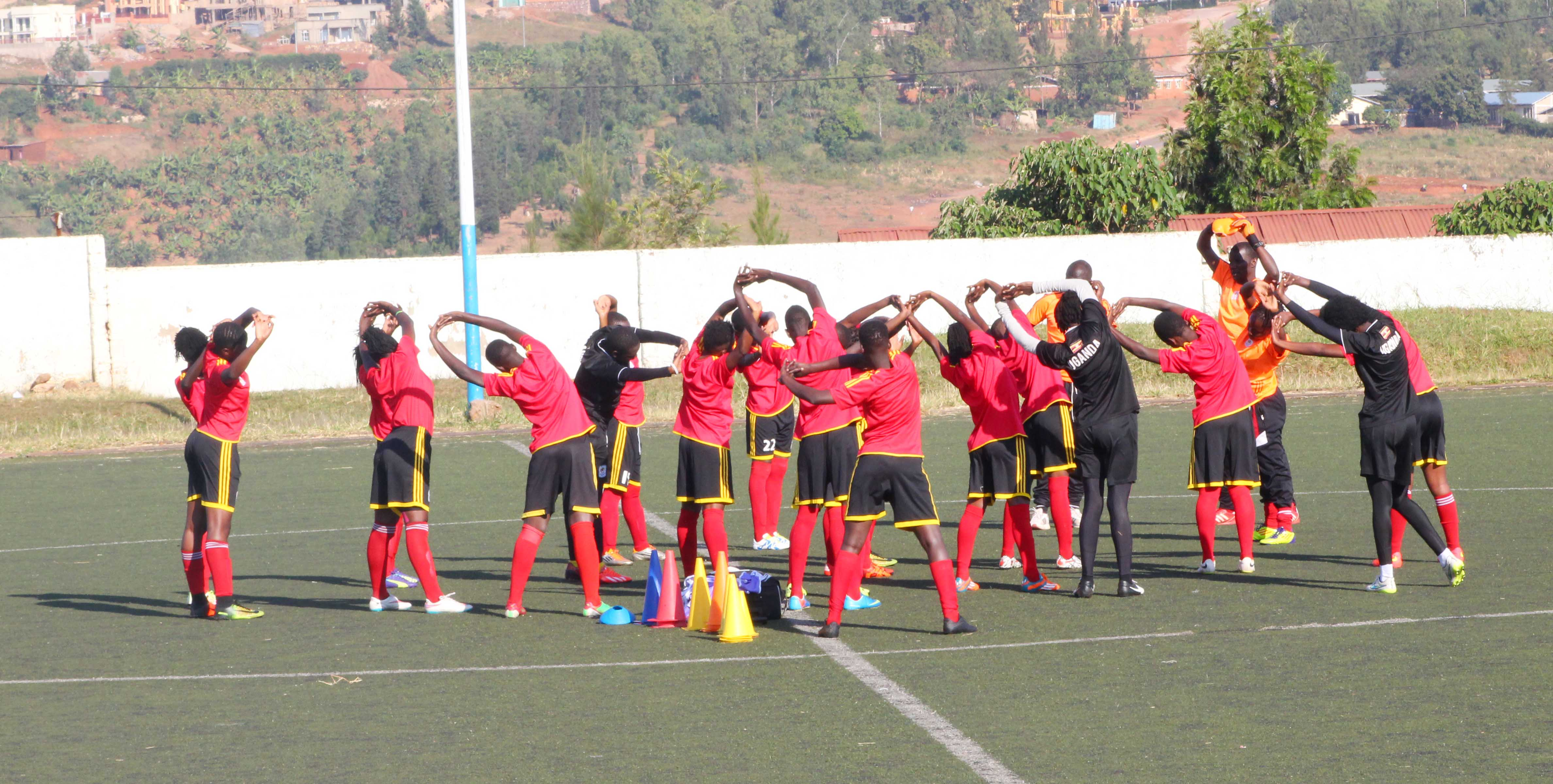 The Crested Cranes players stretching during a training session in Kigali earlier this week (Photo by FUFA Media)