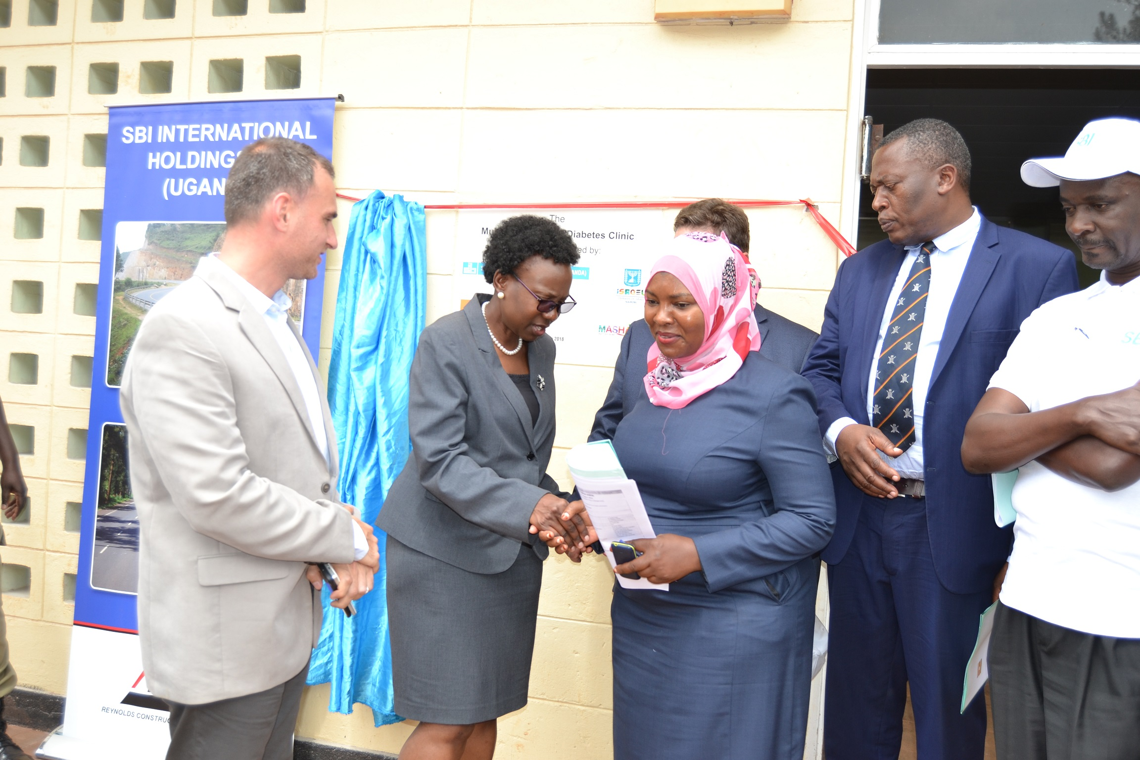 Minister Aceng, Israel Embassy delegation, SBI Uganda officials and Kiboga district officials launching the diabetic Unit at Kiboga hospital (PML Daily PHOTO)