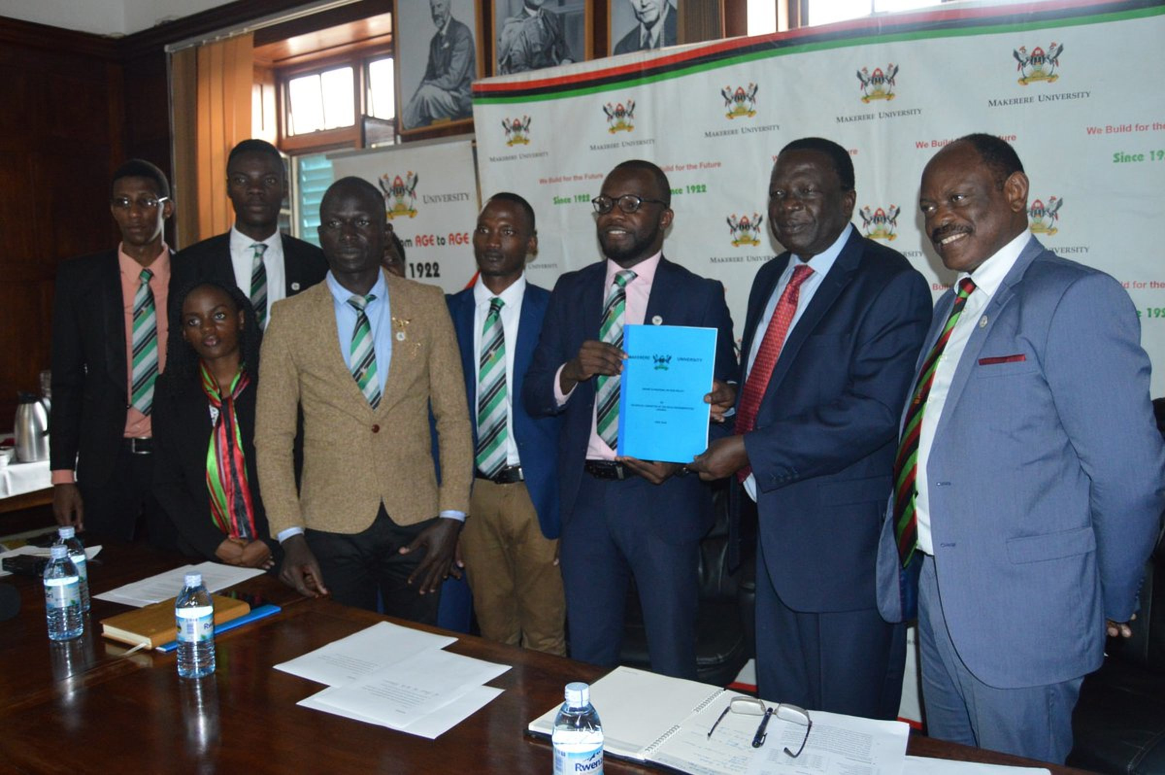Makerere University Guild Committee led by Guild President Papa Were Salim (3rd Right) hands over a report on fees structure to Chairperson University Council Eng. Dr. Wana Etyem on 2nd July 2018. Right is the Vice Chancellor Prof. Barnabas Nawangwe (Credit: MUK)