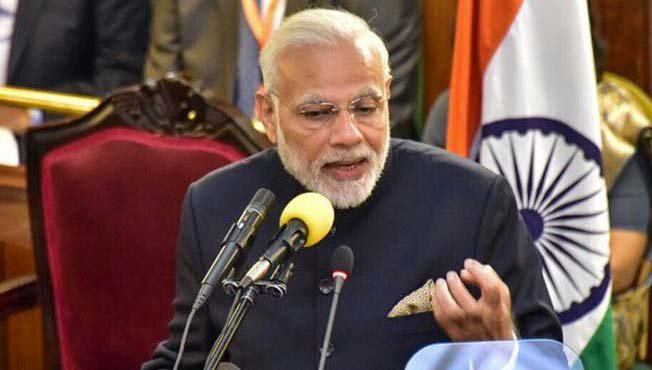 India PM Modi stresses a point as he address Parliament on his two-day state visit in Uganda (Photo: PMO)