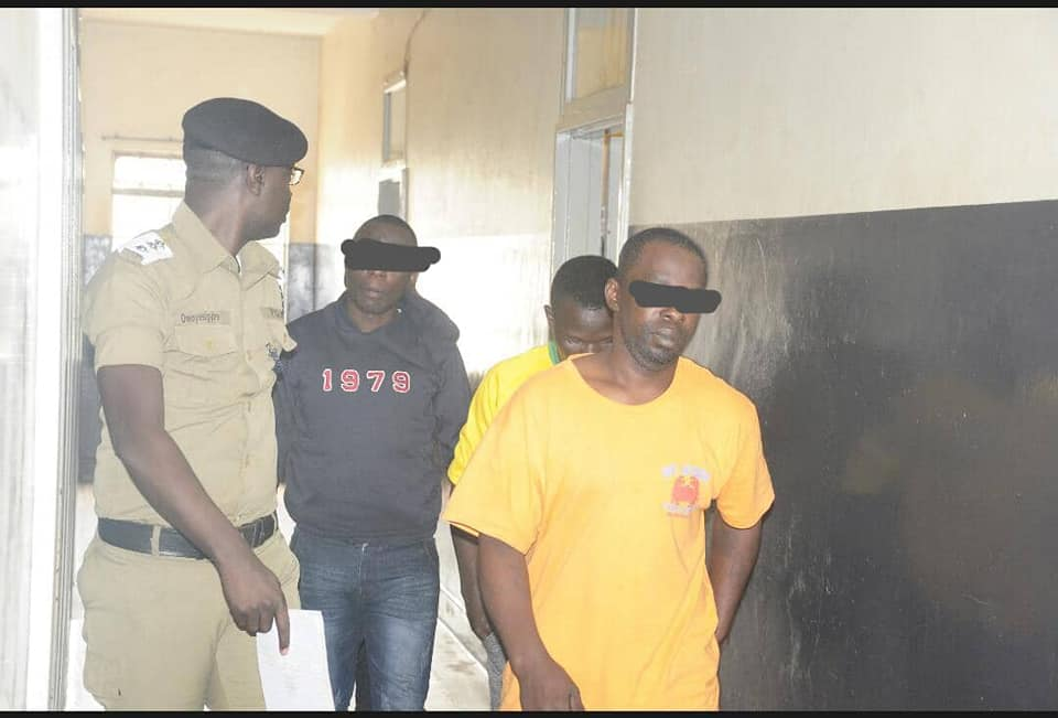 Kampala Metropolitan Police spokesperson Luke Owoyesigyire parades the suspectd before the press