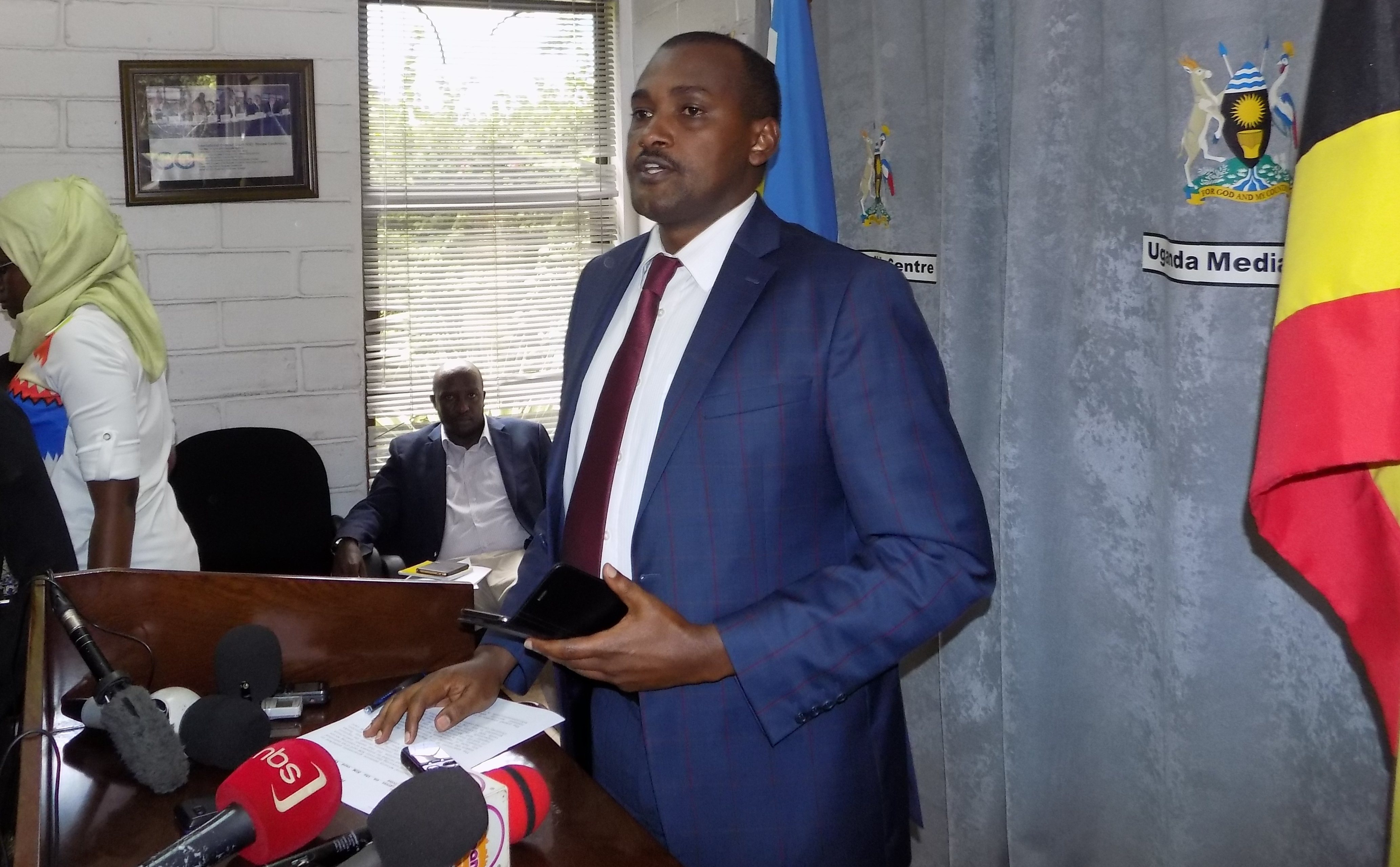 Minister of ICT, Frank Tumwebaze addresses journalists at the Uganda Media center.