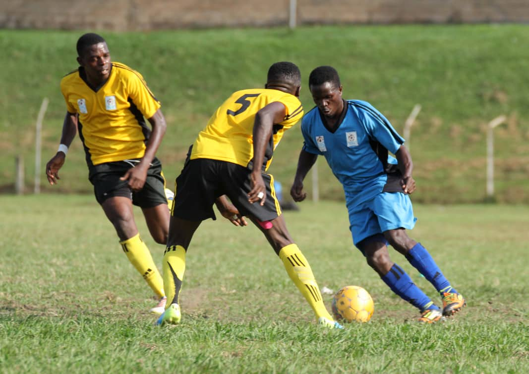 Buganda's Vianne Ssekajugo (right) tries to get past Kampala's Siraje Ssentamu as Martin Kizza looks on. Ssekajugo scored the opener in the game. (Photo by FUFA Media)