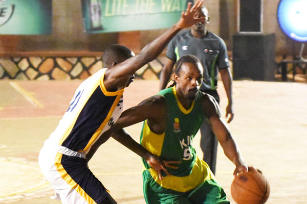 KIU's Chris Omanyi (right) is expected to return this evening against UCU (File Photo)