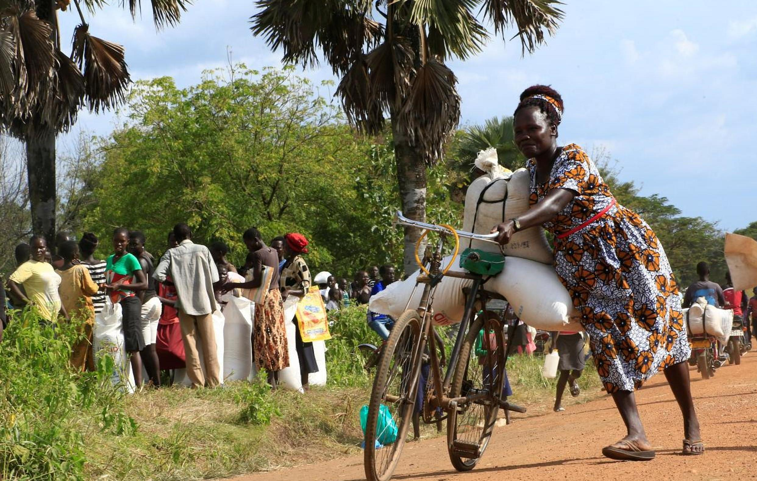 A refugee from South Sudan transports food.  (FILE PHOTO)