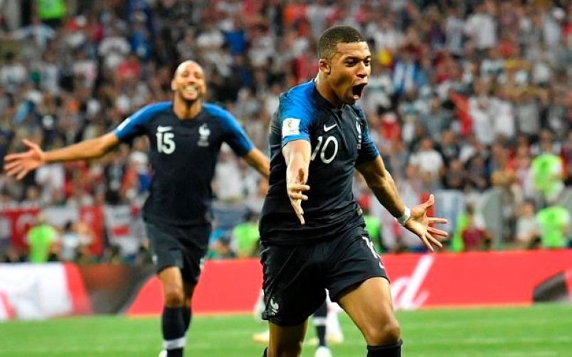 Mbappe celebrates scoring the fourth goal against Croatia