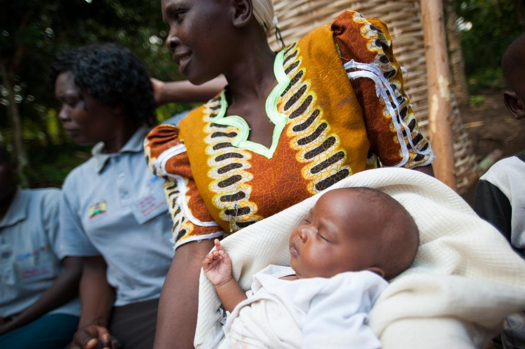 A young mother awaits to receive post/neo-natal child hea;th care service. THe USAID has pledged continued support with a boost in funding (FILE Photo)