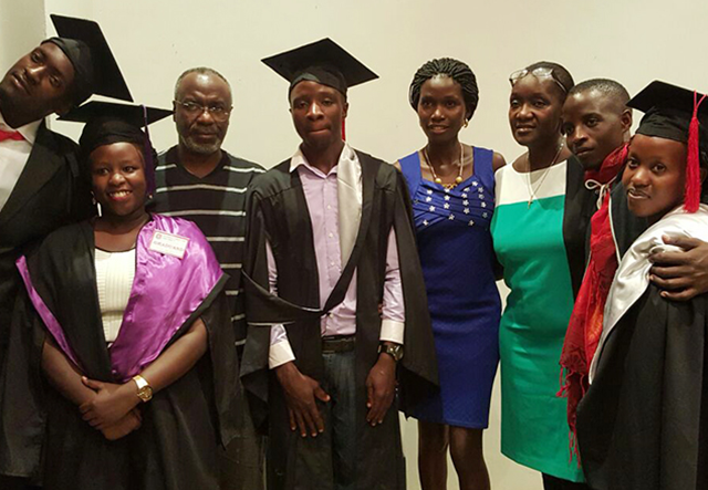 Dr. William Muhairwe (3rd left) and his wife (3rd right) pose for a picture with some of the beneficiaries on their graduation day. A new list of beneficiaries has been released (FILE PHOTO)