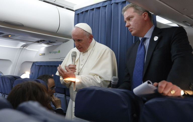 Pope Francis speaks to reporters aboard his plane from Dublin on Monday ( PHOTO -- CNS).