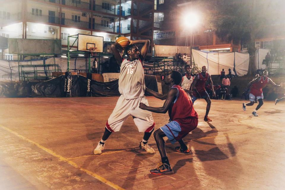 UCU Canon's Fadhili Chuma (16) attempts a pass against Sharing Youths on Wednesday evening