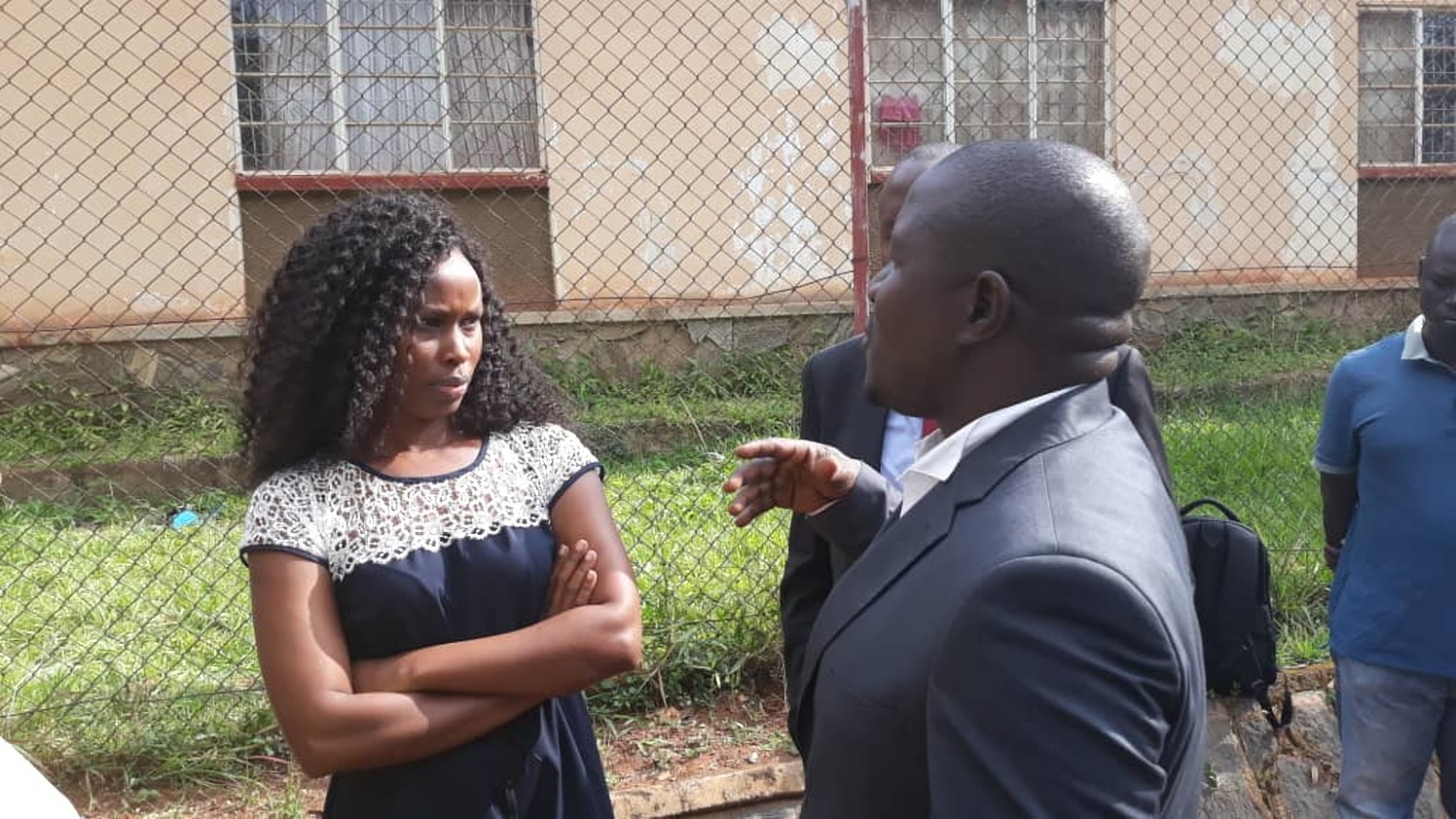 Barbie Kyagulanti, wife to the incarcerated Kyadondo East MP Robert Kyagulanyi, standstill with Bugiri Municipality MP Asuman Basalirwa after the military denied their access to the court martial (PML Daily PHOTO)