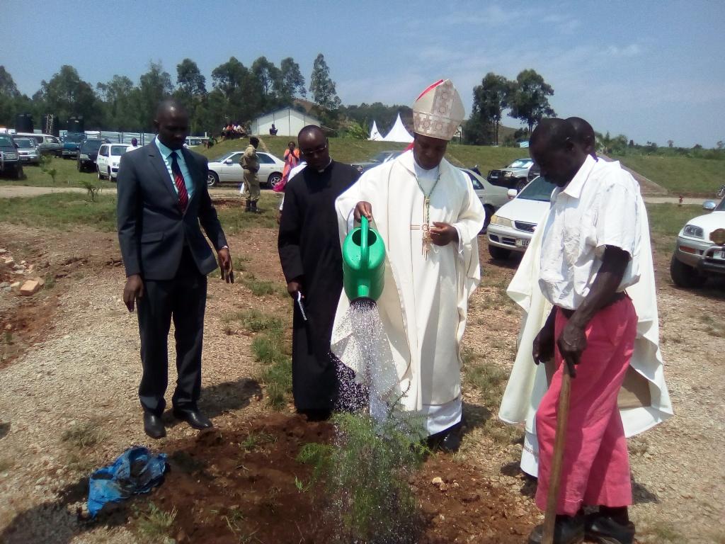 Bishop Lambart Beinomugisha watering the tree at St Augustine Minor Seminary Rweera, Ntungamo (PML Daily PHOTO)