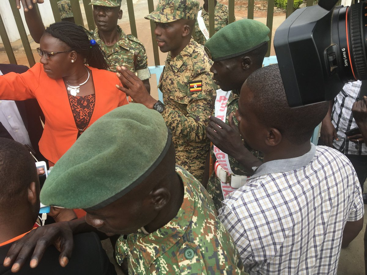 The family of Kyadondo East MP Kyagulanyi wrestle with Military officers to access the court martial in Gulu (PML Daily PHOTO)