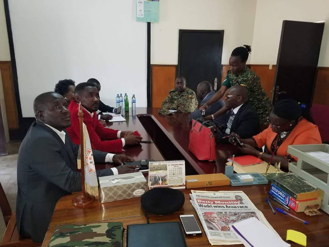 Lawyers Asumani Basalirwa (L) and Medard Segona (R), the jailed MPs have signed bail application papers in Gulu Central Prison
