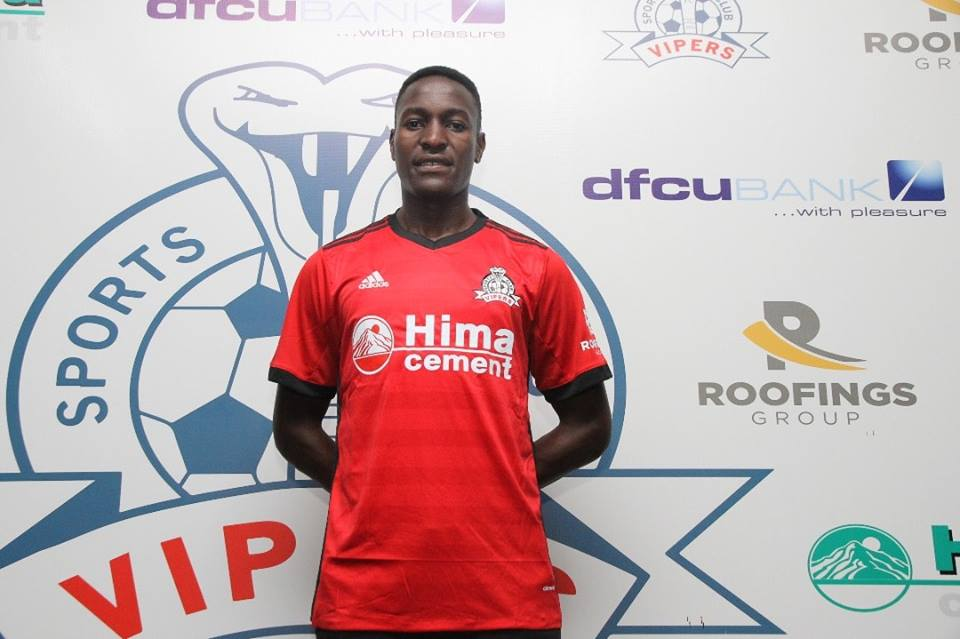 Henry Katongole posses for the Camera's at his unveiling as a Vipers' player (photo by Vipers' media)