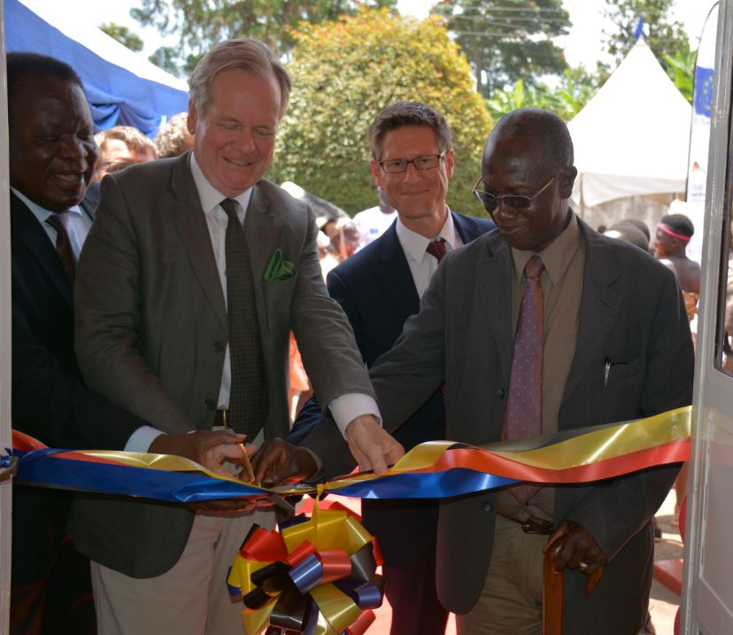 LC V boss Bernard Mujasi (L) H..E. Dr. Albrecht Conze the German Ambassador to Uganda (C) and the Bamasaaba Cultural leader Bob Mushikori cut the ribbon while opening GIZ office in Mbale (PML Daily PHOTO)