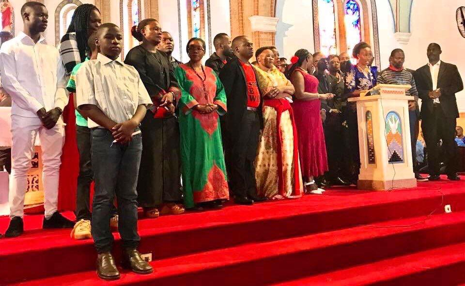 Family and relatives of the incarcerated Kyadondo East MP Robert Kyagulanyi and tortured Francis Zaake at the altar during the mass held at Lubaga Cathedral August 22 (PML Daily PHOTO)