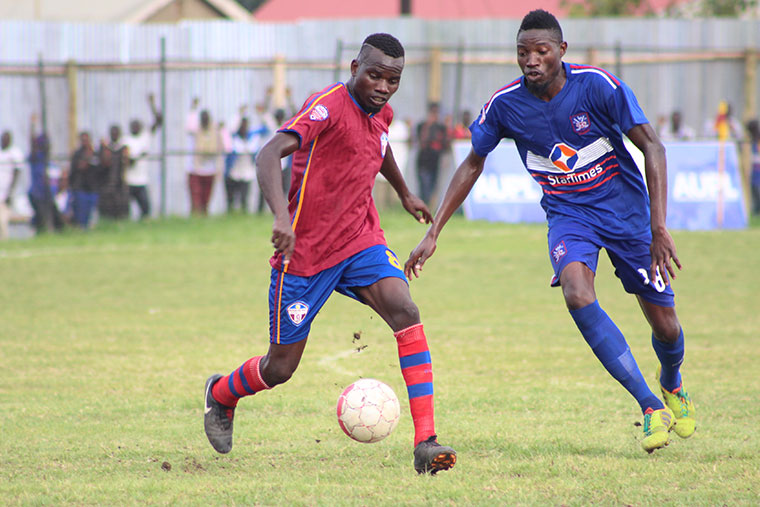 Yubu Bogere (right) in action against Maroons Fc last season (file photo)