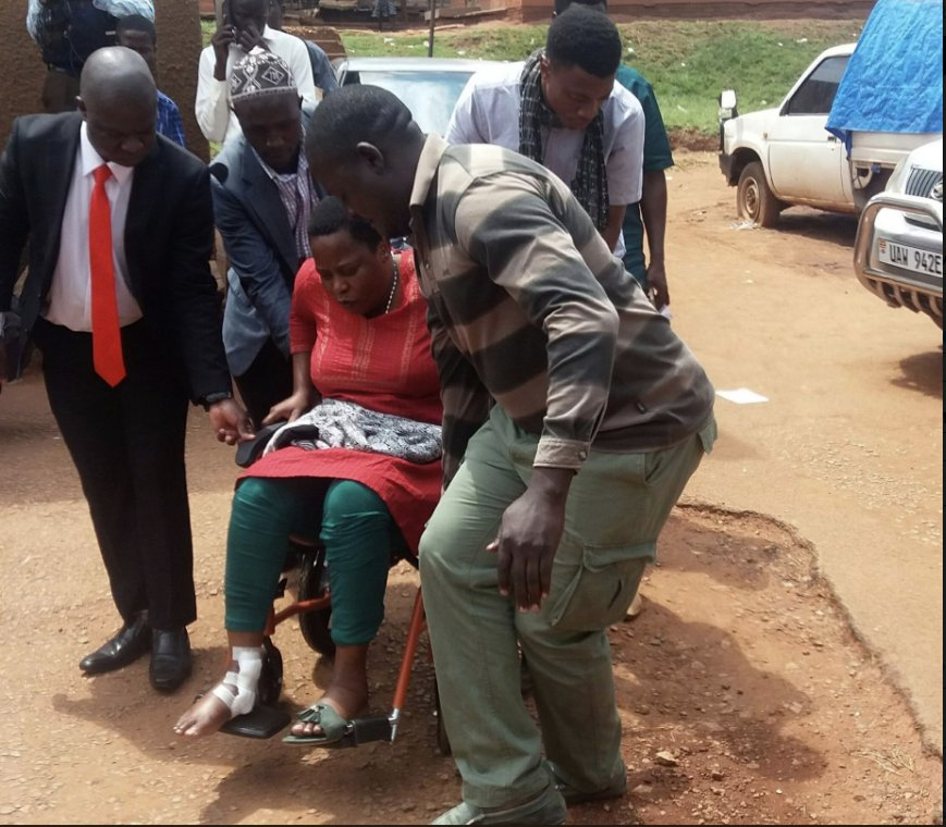 Mukono Municipality MP Betty Nambooze is helped to the Nakawa Magistrate upon arrive before charged with inciting violence and released on bail (PML Daily PHOTO)