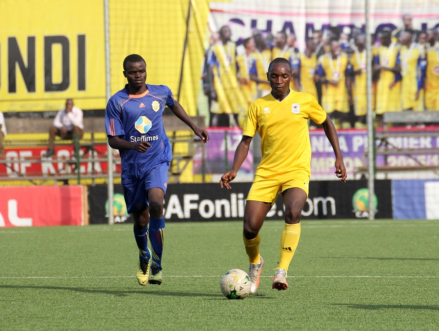 Kasozi (right) has failed to tie down a spot in KCCA FC'S starting line up (File Photo)