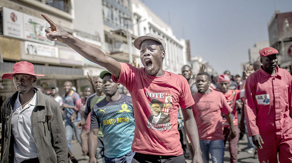 Supporters protest against alleged widespread fraud by the election authority after the announcement of election's results, in the streets of Harare on Wednesday
