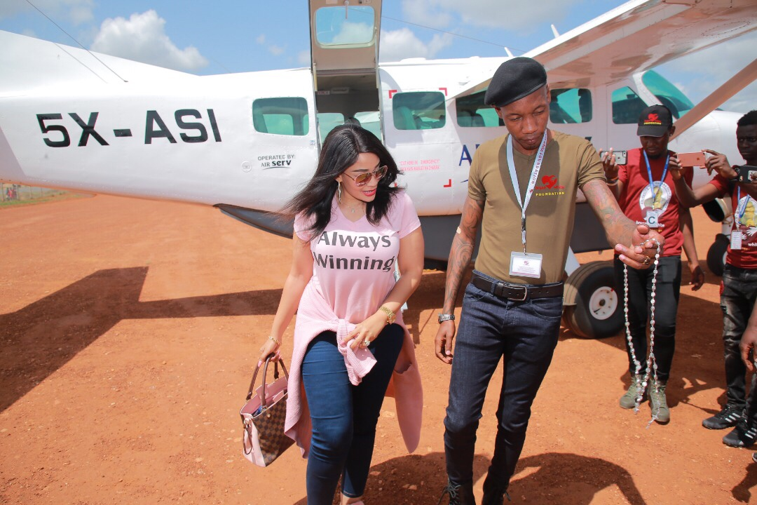 Brian White Foundation CEO Bryan White welcomes the Foundation Brand Ambassador at the Arua Airfield. (Courtsey Photo)