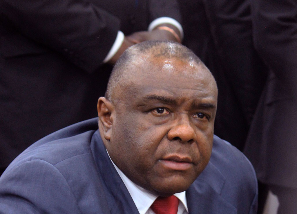 Jean-Pierre Bemba looks on as he arrives at Kinshasa airport