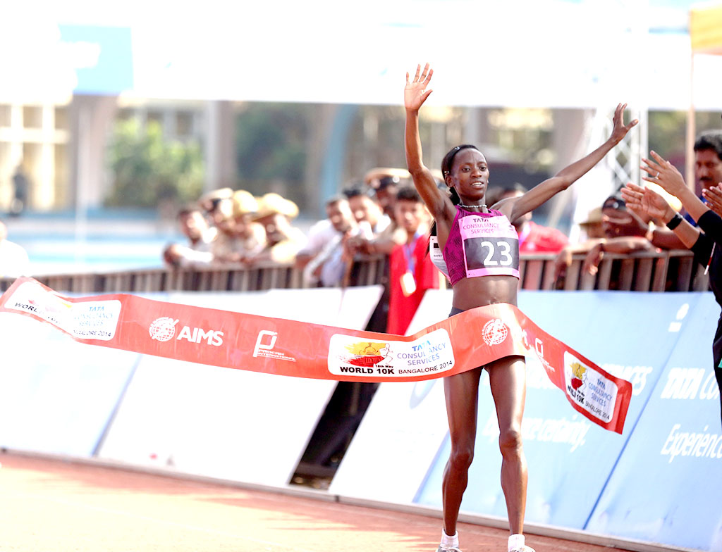 Kenya's Lucy Kabuu crosses the finish line in 00:31:48 seconds to win the overall women's title at the TCS World 10K Bangalore 2014.
