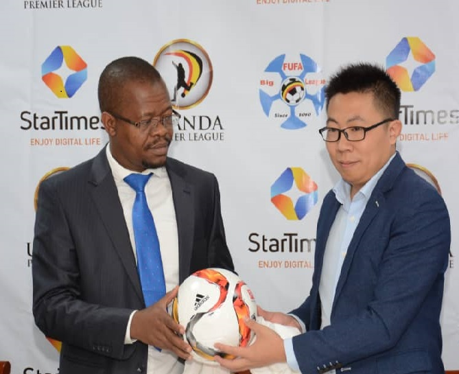 FUFA President Eng. Moses Magogo (left) and StarTimes CEO Andy Wang (right) at the launch of the Startimes-Fufa partnership on Thursday morning (file photo)