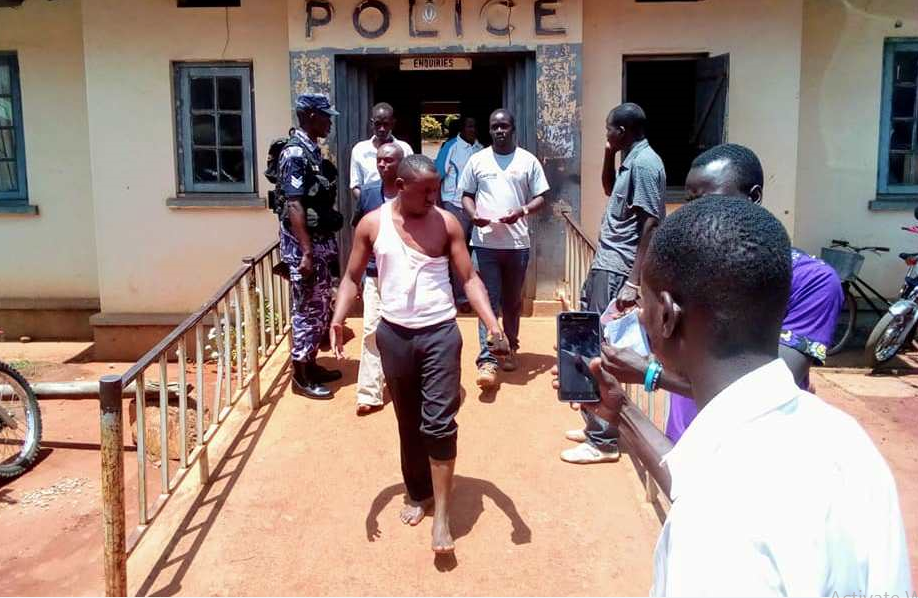 Brutally arrested journalists, Zziwa Herbert and Ronald Muwanga at Gulu Police Station where they were allegedly charged with inciting violence and malicious damage in the Monday, August 13 scuffle in Arua (FILE PHOTO)