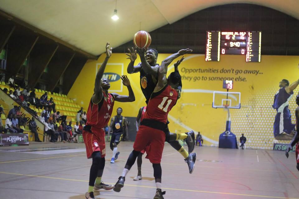 JKL's Ivan Lumanyika trys to throw down a lay up under the watch of Warriors' Said Amis (11) on Friday night (photo by FUBA Media)