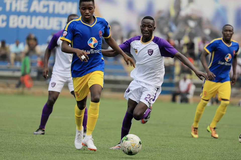 KCCA FC forward Allan Okello (left) in action against Wakiso Giants at the StarTimes Stadium on Friday (Photo by Wakiso Giants Media)