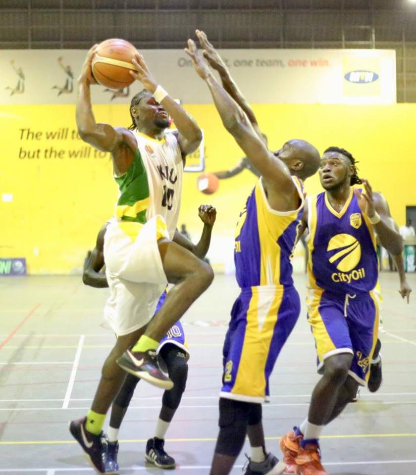 Titan's Micheal Bwanga (10) tries to sink a layup over Stephen Omony as Landry Ndikumana looks on (Photo by FUBA Media)