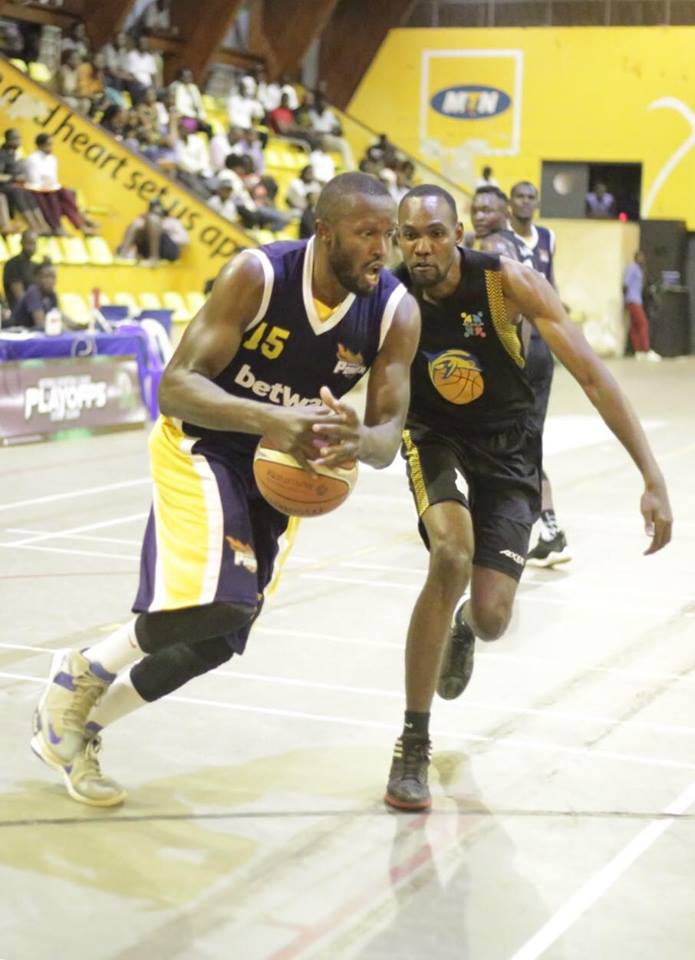 Power's Philip Amanyi (15) holds onto possession against JKL Dolphins on Wednesday night (photo by FUBA)