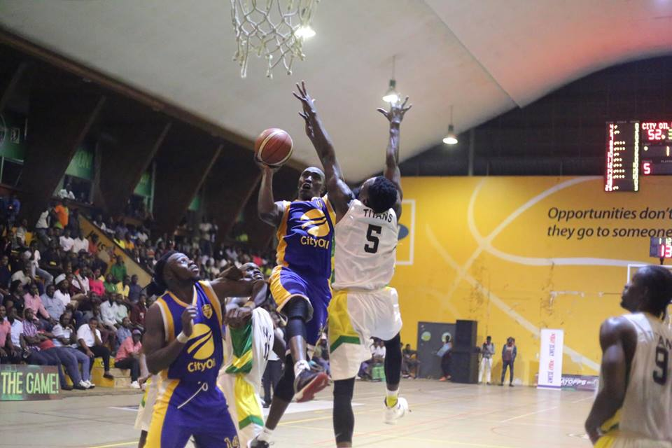 Oilers' Stephen Omonyi tries to sink a lay-up under the watch of Titan's Ethiene Kazungu (5) as Landry Ndikumana (14) looks on last night (photo by FUBA media)