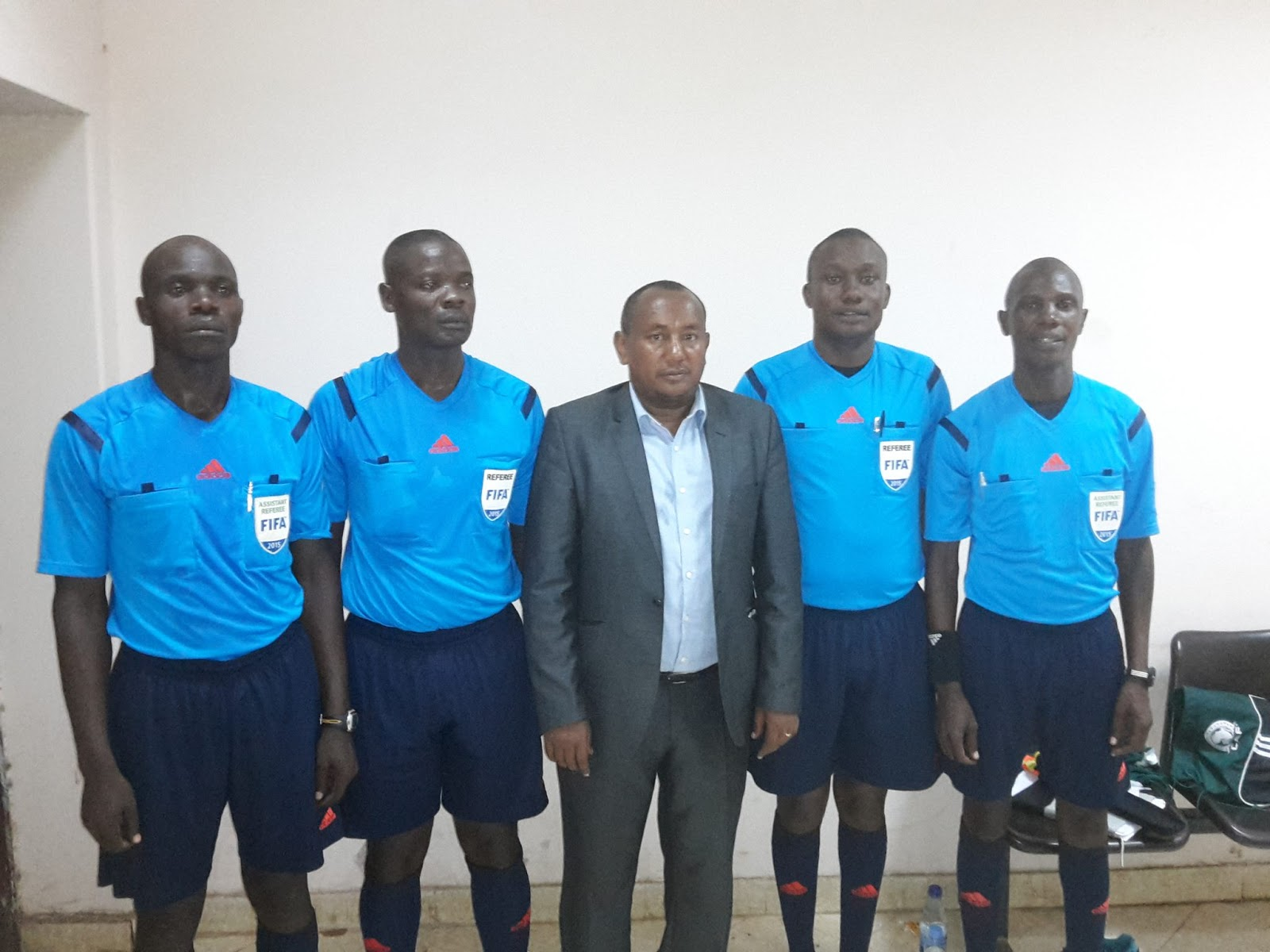Nsubuga (second right) will be the center referee for the Super Cup on Saturday (file photo)