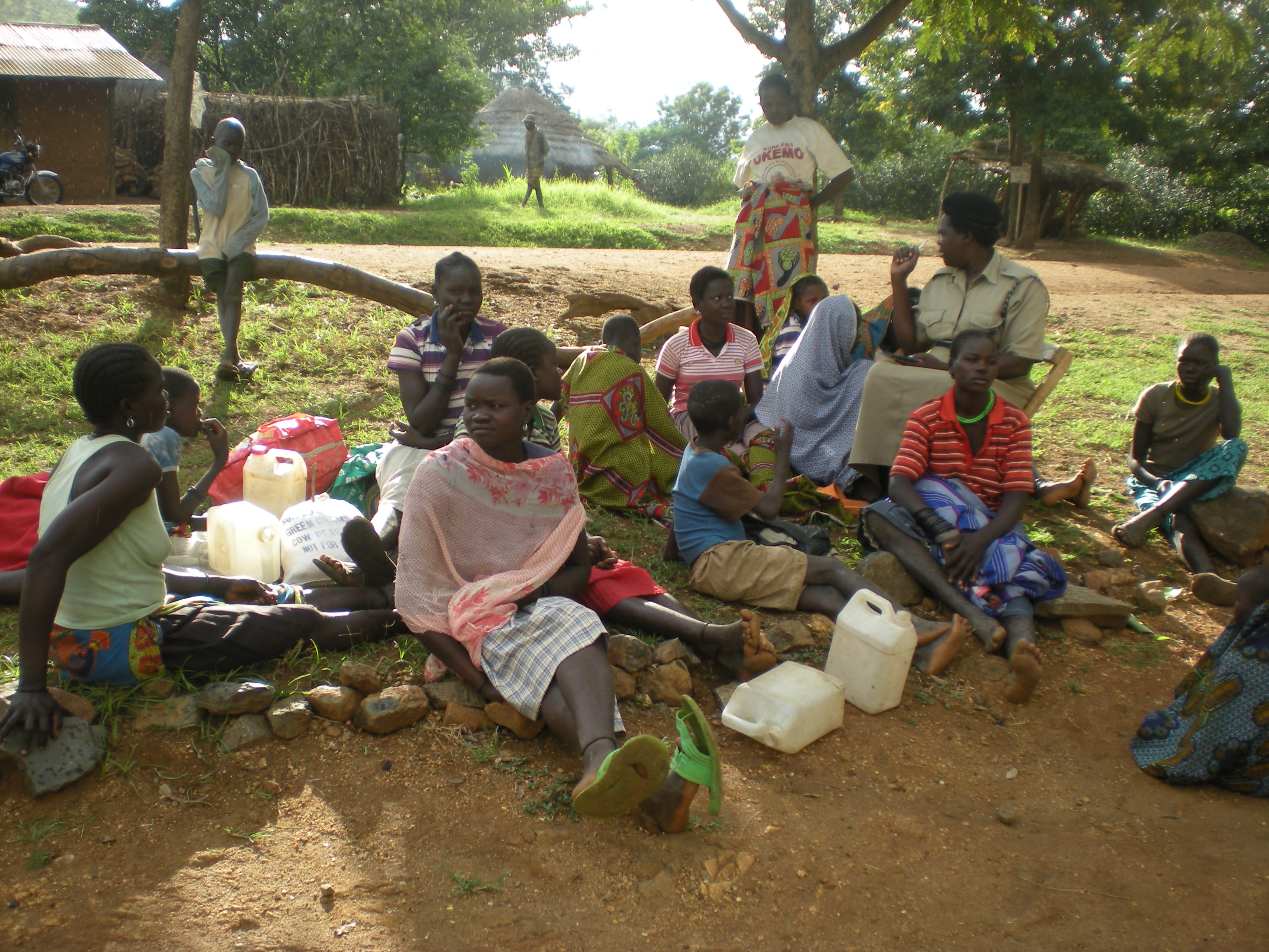 Children sit with a police officer in Karamoja after they were intercepted enroute to Kampala. (PHOTO: David Mafabi)