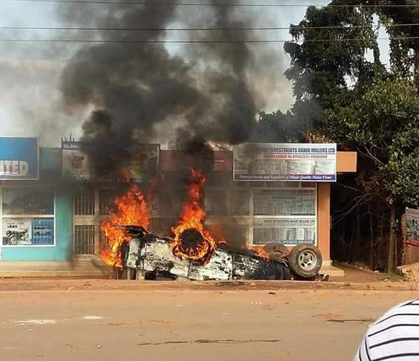 Angry residents of Nansana town this morning turned rowdy and torched a Pajero registration number UAM 617D beyond recognition.  (PML Daily PHOTO)