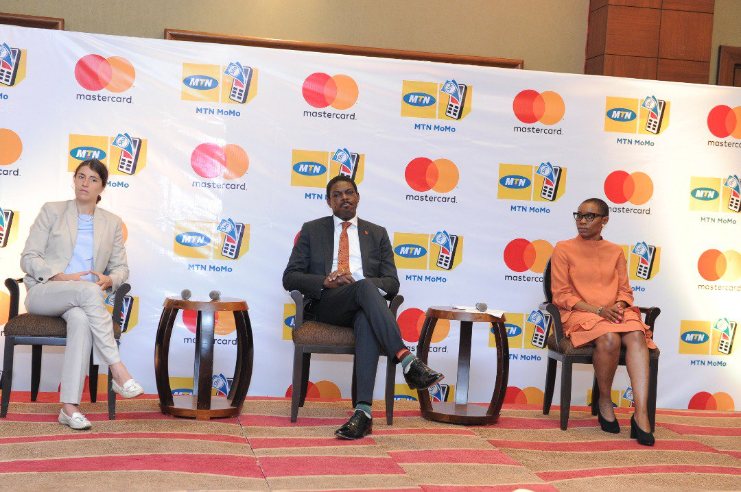 UBA Uganda MD, Mr. Johnson Agoreyo joins MTN executive at the unveiling of the MTN MoMoCard in partnership with MasterCard Foundation (FILE PHOTO)