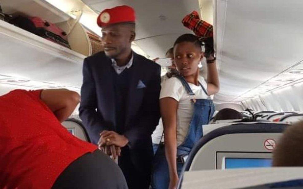 Kyadondo East MP Robert Kyagulanyi alias Bobi Wine  and ASP Kentaro Pamela aboard Kenya Airways plane as it set off for Entebbe at Jomo Kenyatta Airport September 20 (FILE PHOTO)