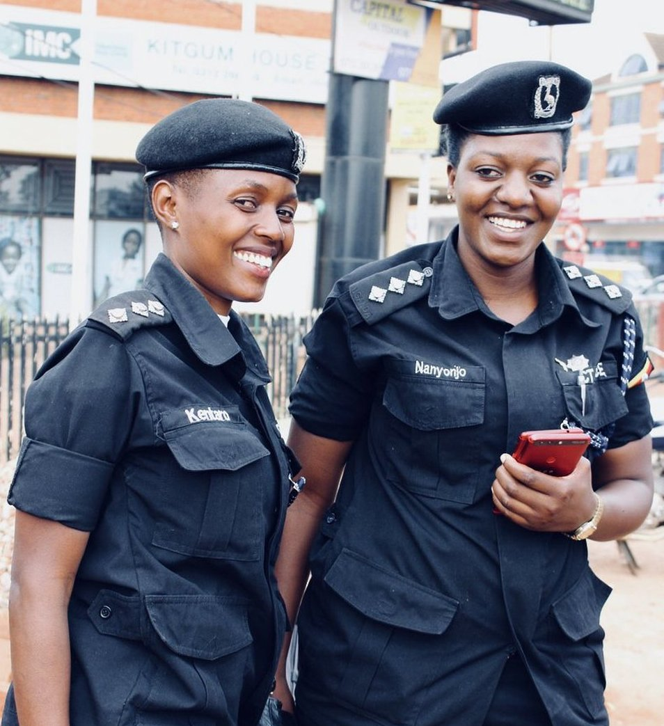 ASP Kentaro Pamela shares a light moment with fellow officer, ASP Nanyonjo. She cleared the air citing that she was from a training course in Mombasa (FILE PHOTO)